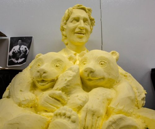 Justin Trudeau's famous panda cuddle sculpted in butter