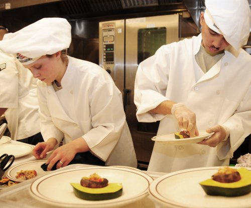 Teaching teens to cook sets table for healthy eating as adults
