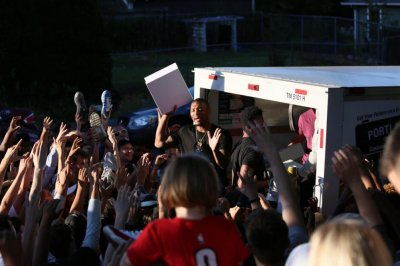 Damian Lillard gives away shoes out of U-Haul in Portland