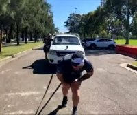 Australian runs marathon in under 17 hours pulling a 1.6-ton truck