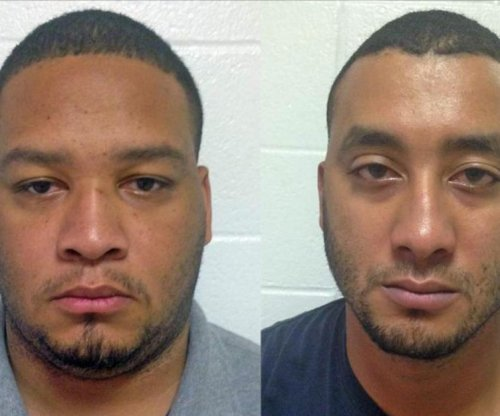 Two Louisiana police officers arrested in shooting death of 6-year-old boy