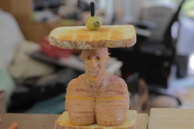 Laser cutter used to assemble ham sandwich bust of Vin Diesel