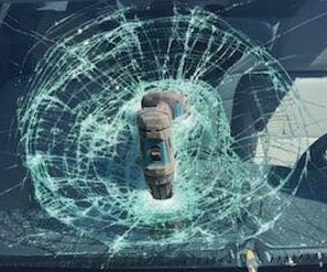 Power drill crashes into windshield of moving car