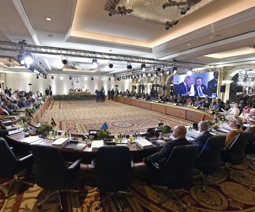 Arab economic summit faces defections over concerns for Syria, Iran