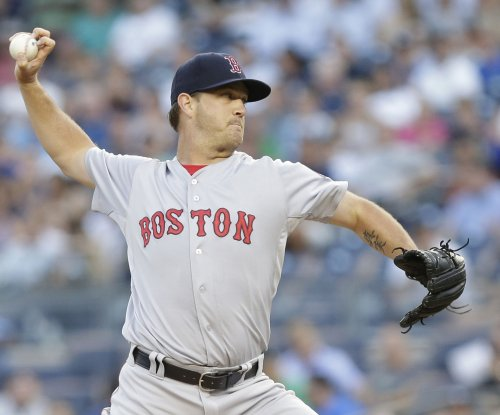 New York Yankees knuckle under against Boston Red Sox's Steven Wright
