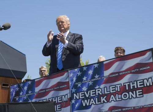Trump vows to support police during memorial, blasts 'defamation'