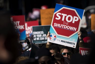 Trump signs bill promising back pay to furloughed federal workers