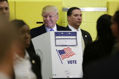 Donald Trump casts vote in NYC hours after topless protesters removed