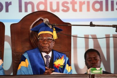 Amid exit strategy, Mugabe makes first appearance since arrest