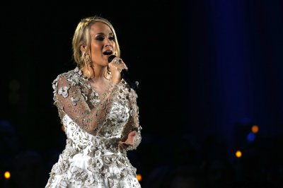 Carrie Underwood shows first baby-bump photo