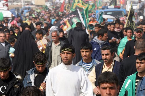 22 dead in Iraq bombings aimed at police and Shiite pilgrims