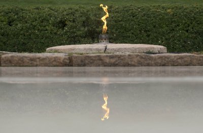 Eternal flame transferred back to permanent place on Kennedy's grave