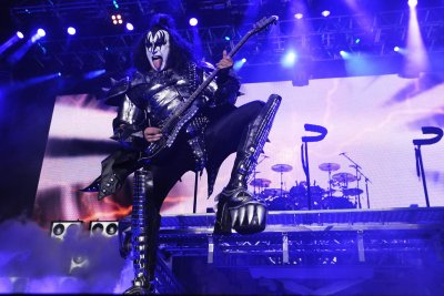 Gene Simmons takes a fall during Kiss concert