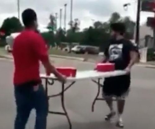 Texas pranksters play game of beer pong at intersection