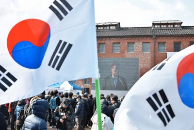 South Korea president assures rivals of continued pressure on North