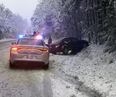 Even as snowstorm leaves N.C., officials urge people to 'stay off the roads'