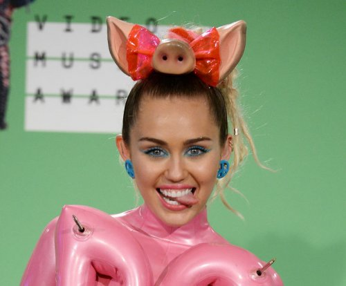 Miley Cyrus reunites with Arnold Schwarzenegger: 'Eat your heart out'