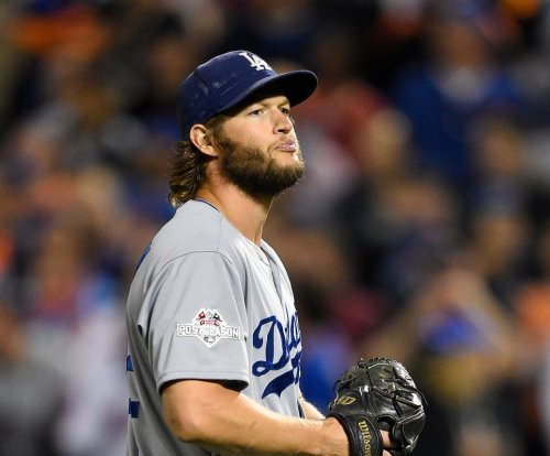 Los Angeles Dodgers' Clayton Kershaw receiving back treatment