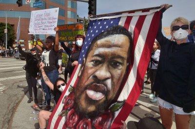 Minnesota to launch civil rights investigation into Minneapolis police