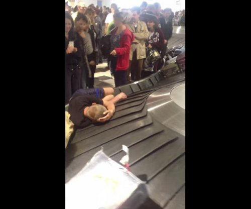 Man sleeps on luggage carousel at Russian airport