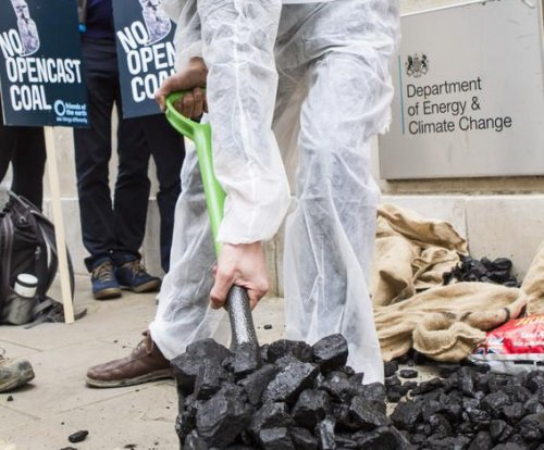 Activists dump coal on British government's door ahead of climate deal signing
