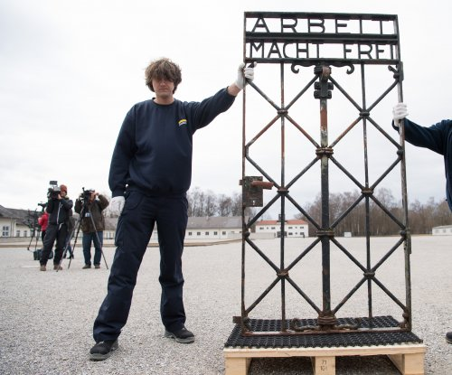 Stolen gate returned to Nazi concentration camp in Dachau