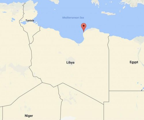 Twin car bombs kill dozens outside Benghazi, Libya, mosque