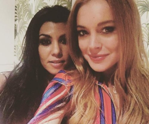 Kourtney Kardashian visits Lindsay Lohan in London
