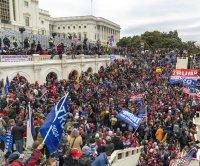 Prosecutors: 'QAnon Shaman' sought to 'violently overthrow' Capitol