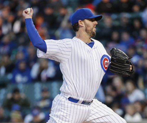 John Lackey helps Chicago Cubs split doubleheader with Colorado Rockies