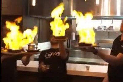Flaming cheese dish sets off restaurant's sprinklers