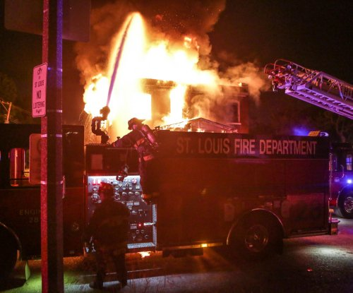 Fires, looting in St. Louis after allegedly armed man killed by officers