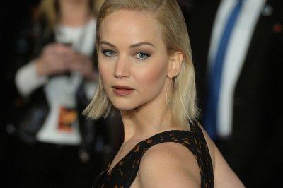 Jennifer Lawrence, Liam Hemsworth attend 'Mockingjay Part 2' U.K. premiere