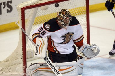 John Gibson helps Anaheim Ducks sweep Calgary Flames, advance to second round