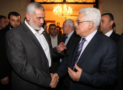 Abbas in Cairo despite death threats