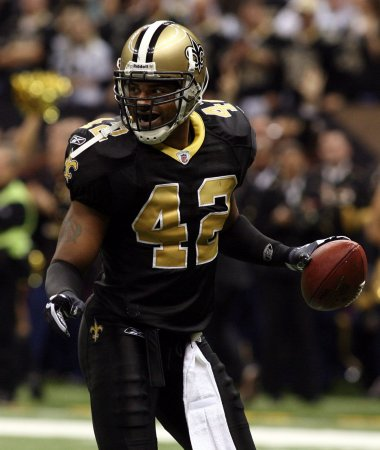 Ex-Saint Darren Sharper surrenders in LA after NOPD issues aggravated rape warrant
