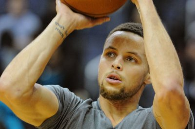Golden State Warriors' Stephen Curry scores 35 in 123-116 comeback win over Phoenix