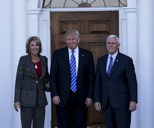 Trump picks school voucher proponent Betsy DeVos as education secretary