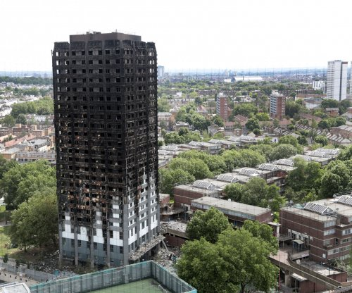 Grenfell Tower fire: May calls for investigation on cladding