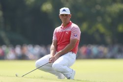 PGA Championship: Woodland sets record, storm suspends second round
