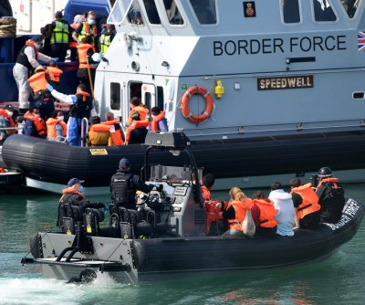 British officials plan to block migrants after 10th day of arrivals