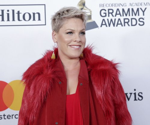 Flu-stricken Pink practices national anthem for Super Bowl