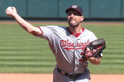 Cardinals' Adam Wainwright outduels Nationals ace Max Scherzer