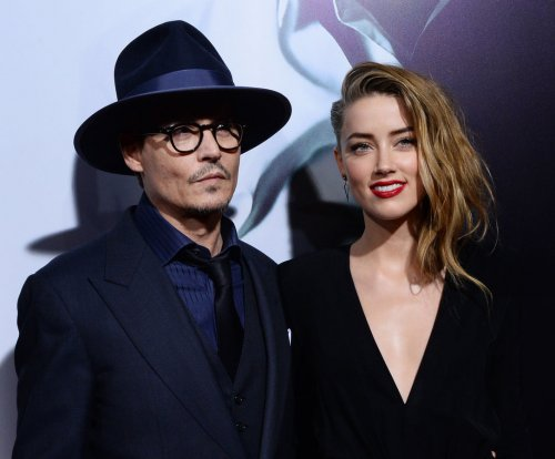 Amber Heard, Johnny Depp reportedly put wedding on hold