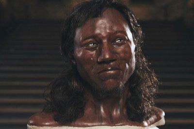 Cheddar Man, first modern Briton, had dark skin and blue eyes