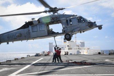Chopper's main rotor struck warship before crash off San Diego, Navy says