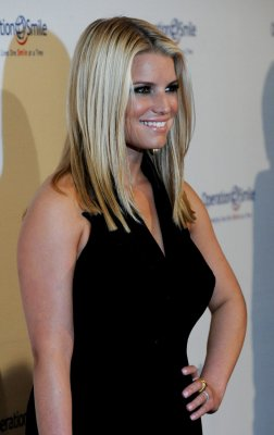 Jessica Simpson shows off svelte figure in canary yellow dress