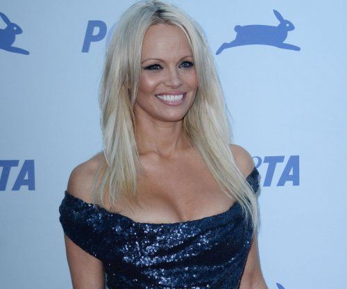 Pamela Anderson joins Miley Cyrus in concert