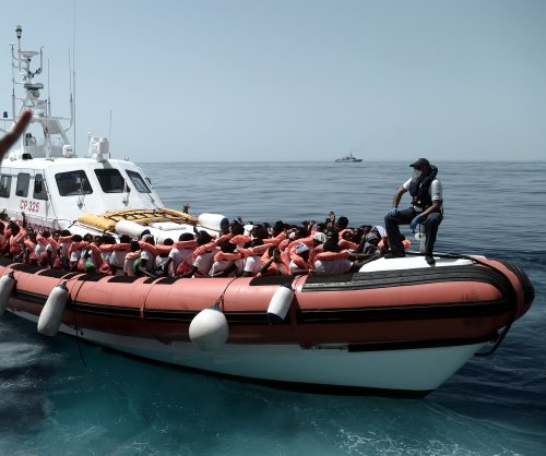 Spain agrees to accept boatload of stranded migrants