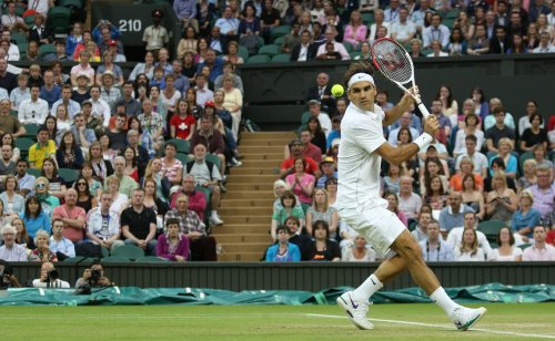 Federer survives five-set challenge